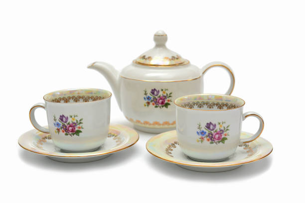 Cups and saucers, tea set on white background stock photo