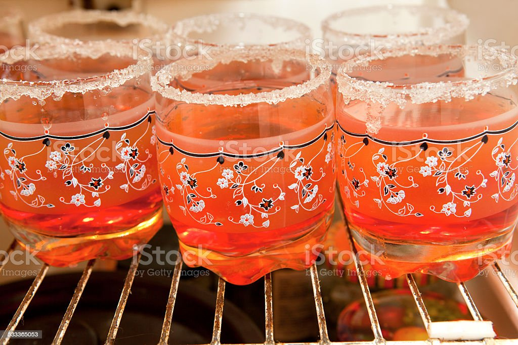 cups in fridger stock photo
