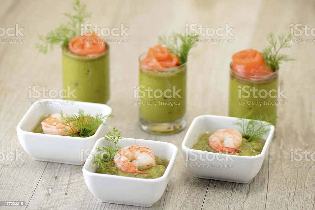 cups of appetizers with green sauce and salmon stock photo