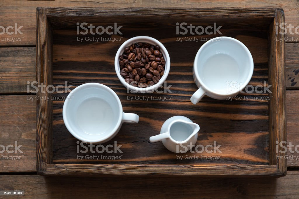 Cups of coffee on dark wooden background. royalty-free stock photo
