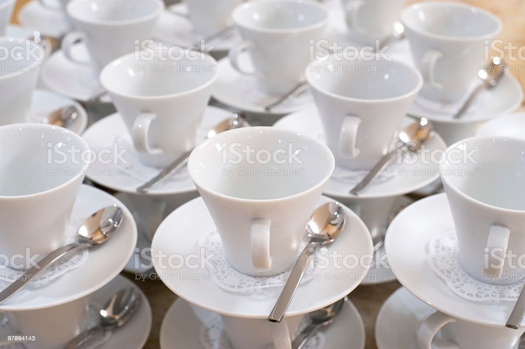 cups on saucers with teaspoons royalty-free stock photo