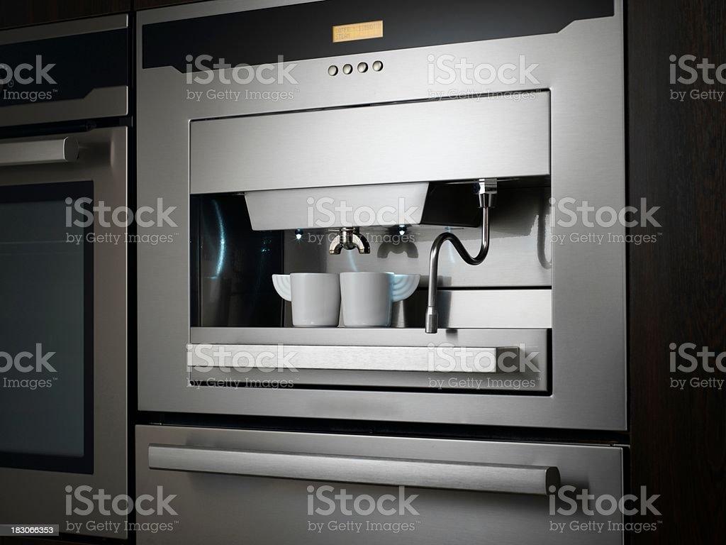 Cups Under Espresso Machine royalty-free stock photo