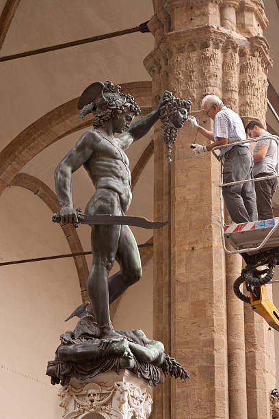 curators care for the statue of perseus - curator stock pictures, royalty-free photos & images