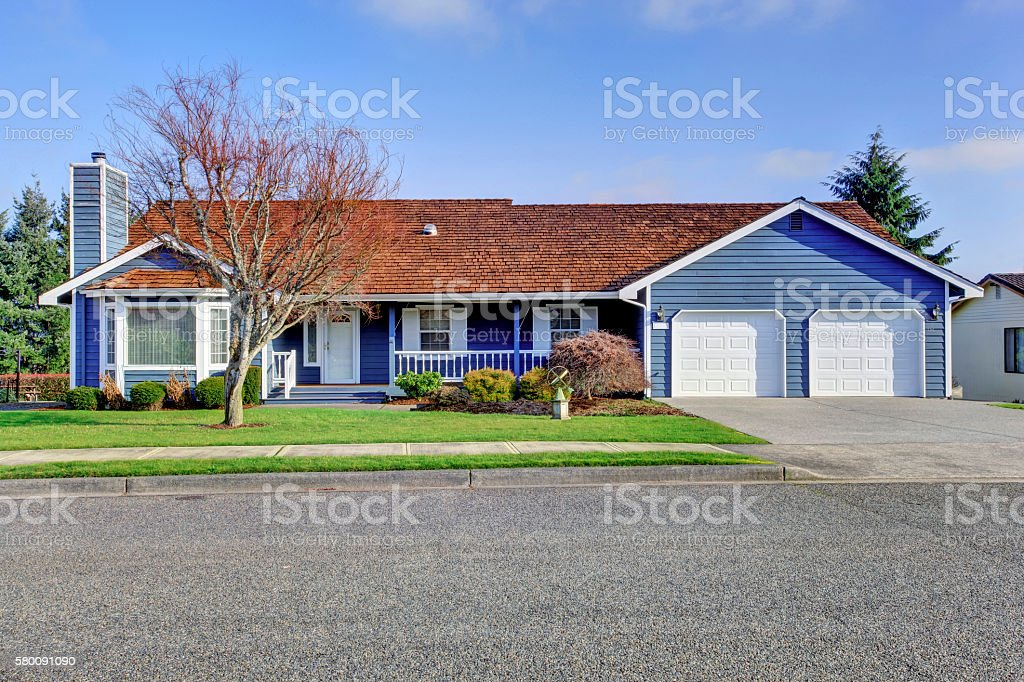 Curb appeal one level American house with white trim stock photo
