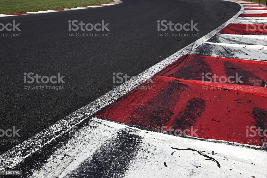 FIA style Kerb on a motorsports race track showing skid marks from...