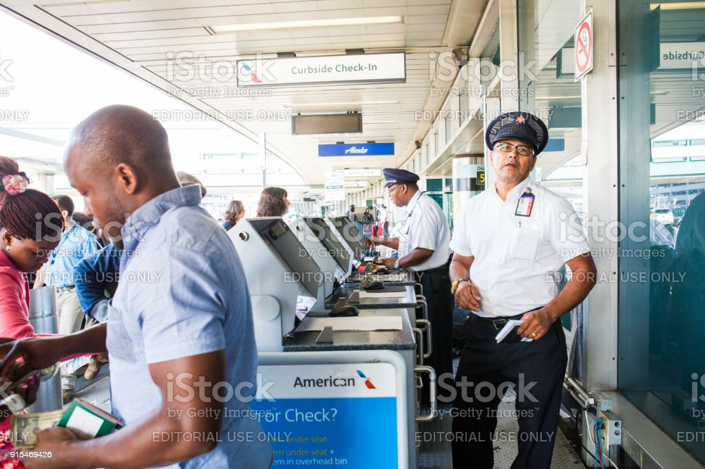 Curbside check-in at airport stock photo