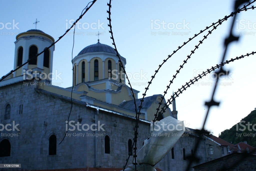 Curch and Barbed Wire stock photo