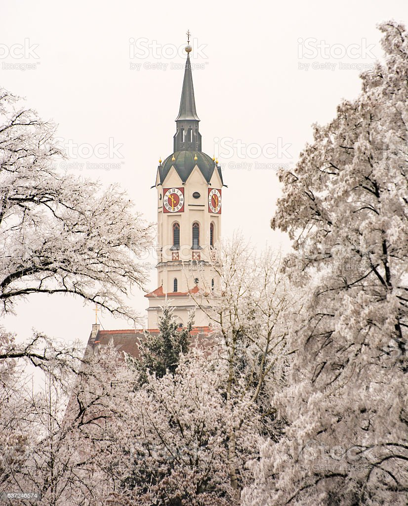 Curch in Schrobenhausen behind frosted trees stock photo