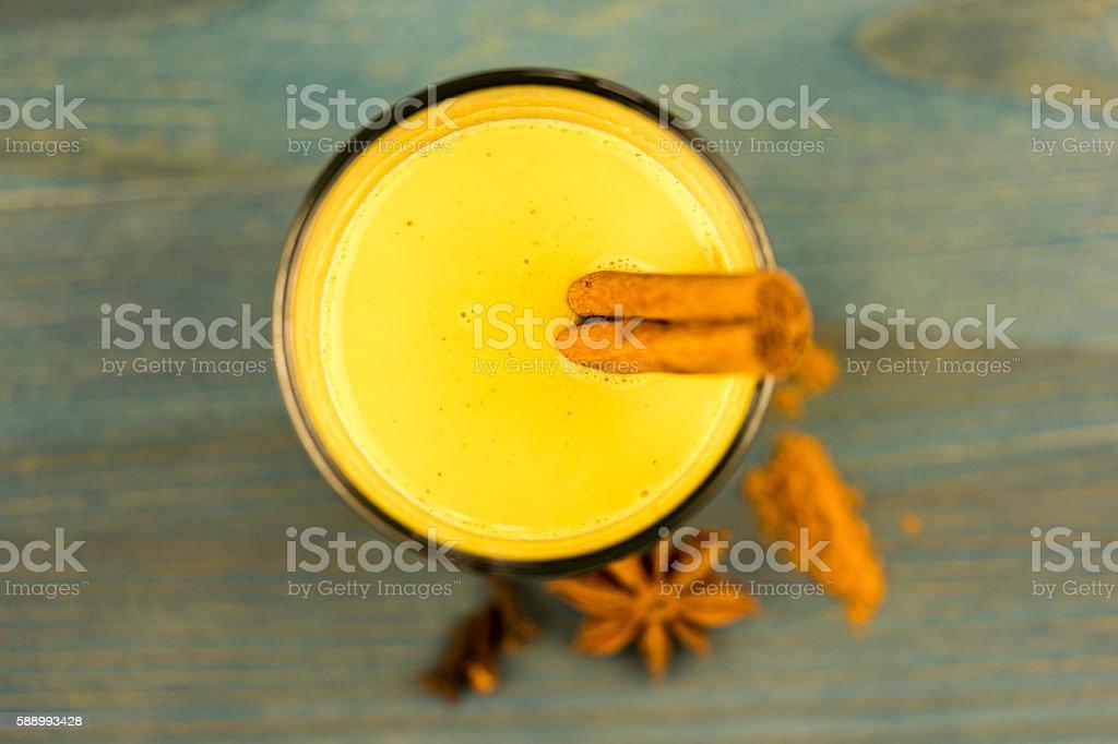 Curcuma drink with cinnamon sticks stock photo