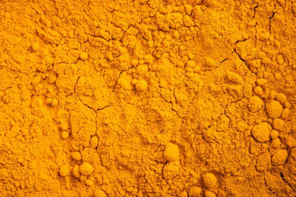 Curcuma Curcuma (Curcuma longa) powder background saffron stock pictures, royalty-free photos & images