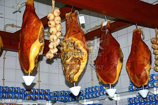 Cured legs of ham for sale in the indoor market, Olhao, Algarve, Portugal, Europe.