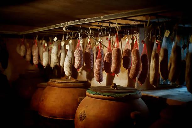 cured meat products - pökeln stock-fotos und bilder