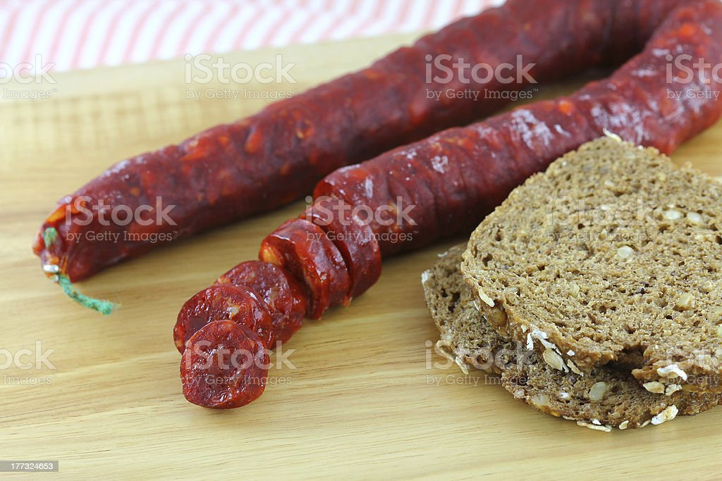 Cured Paprika sausage with wholewheat bread royalty-free stock photo