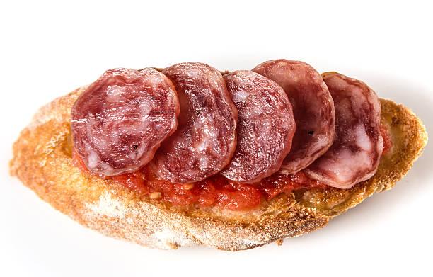 curados salame (fuet) y canapés - fuet sausages fotografías e imágenes de stock