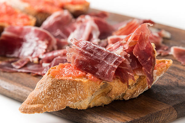 Cured Serrano Ham Canapes Cured Serrano Ham Canapes on white iberian stock pictures, royalty-free photos & images