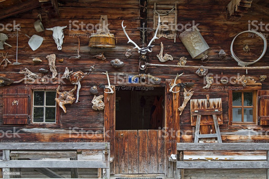 Curious alpine pasture decoration stock photo