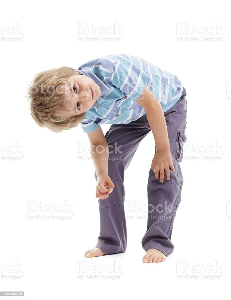 Curious and intrigued boy bending over stock photo