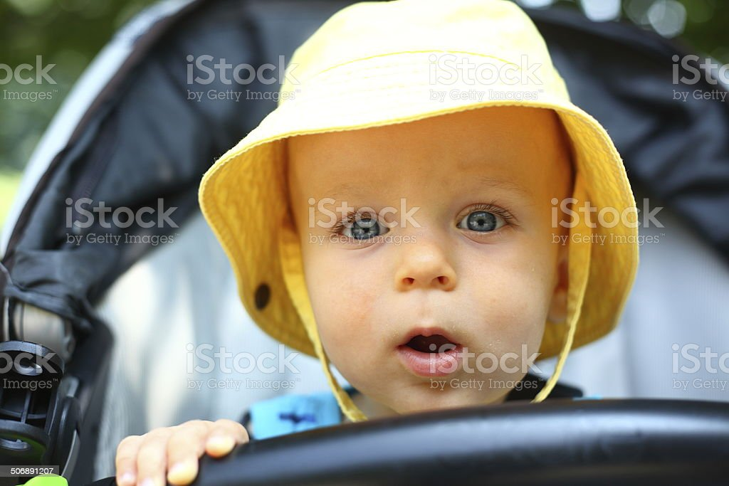 Curious baby boy in a bucket hat stock photo