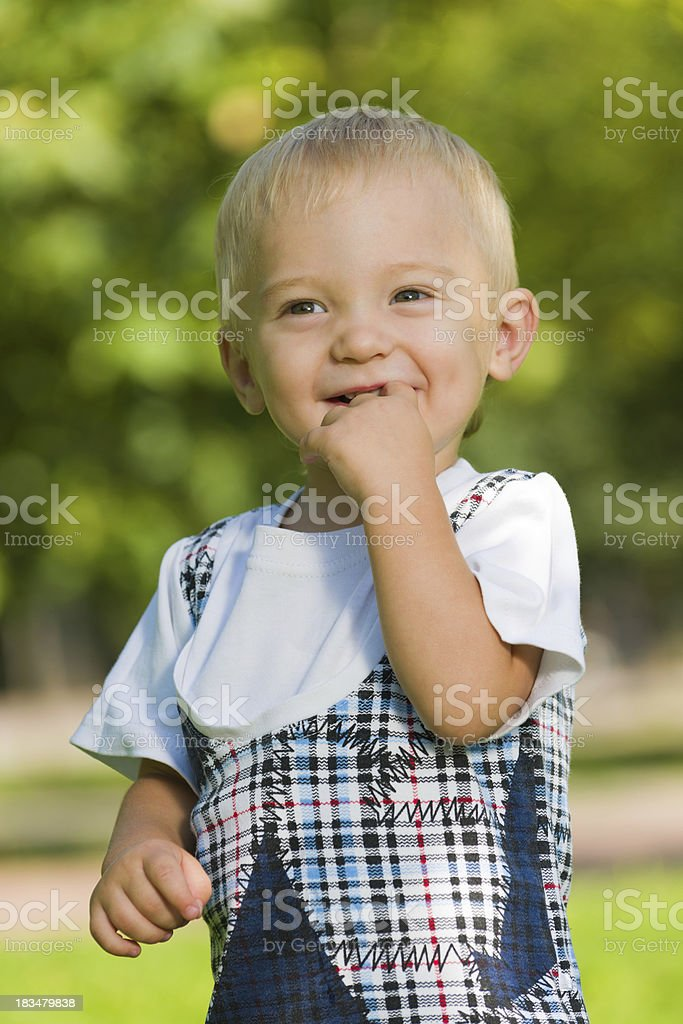 Curious baby boy in the park royalty-free stock photo