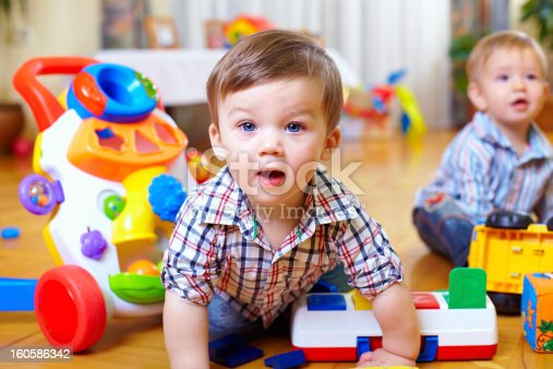 istock curious baby boy studying nursery room 160586342