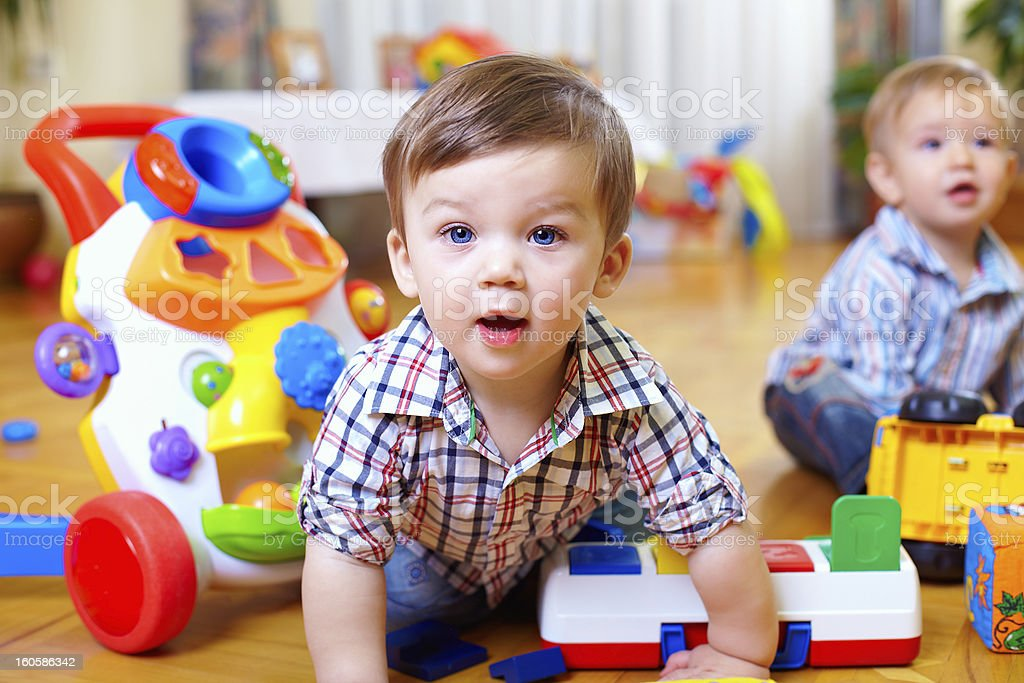 curious baby boy studying nursery room stock photo