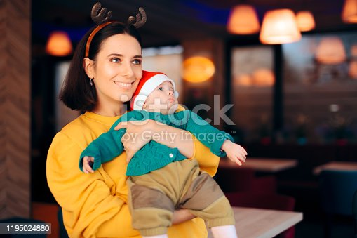 istock Curious Baby Looking for Santa a Christmas Party 1195024880