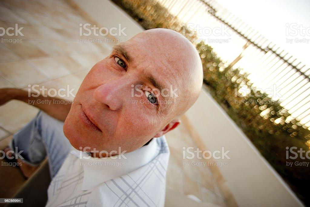 Curious bald man looking at camera royalty-free stock photo