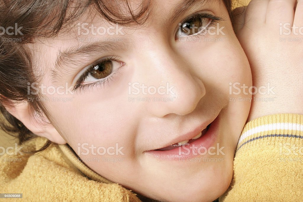 Curious boy looking at you royalty-free stock photo