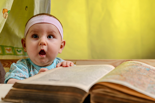 Curious Cute Baby In A White Bandage Learn To Read A Book