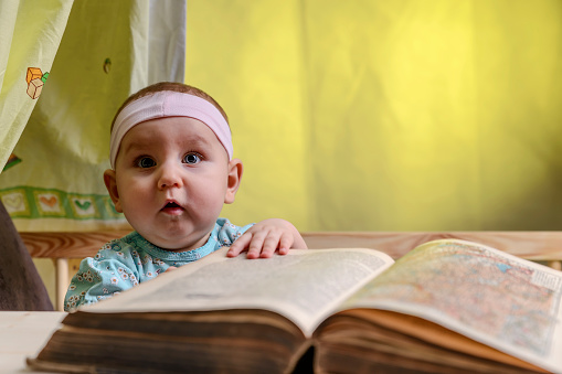 Curious Cute Baby In A White Bandage Learn To Read A Book Stock Photo Download Image Now