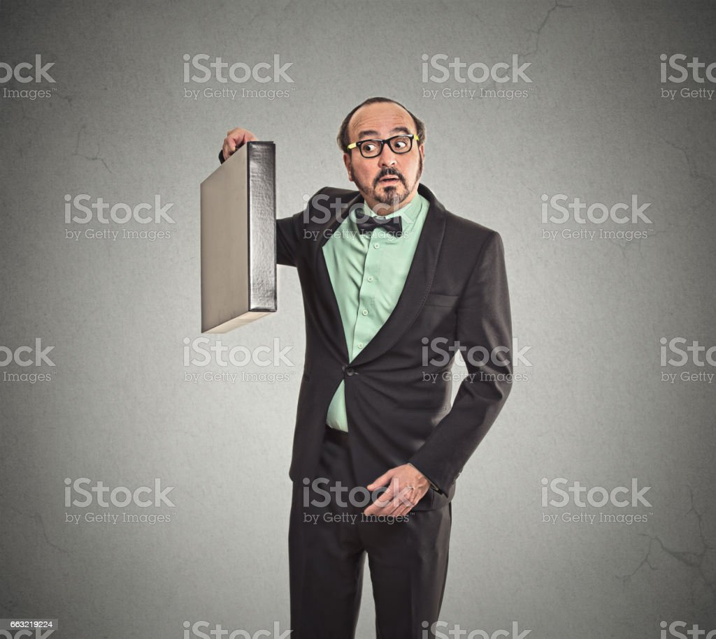 Curious funny looking business man guessing what inside his new briefcase