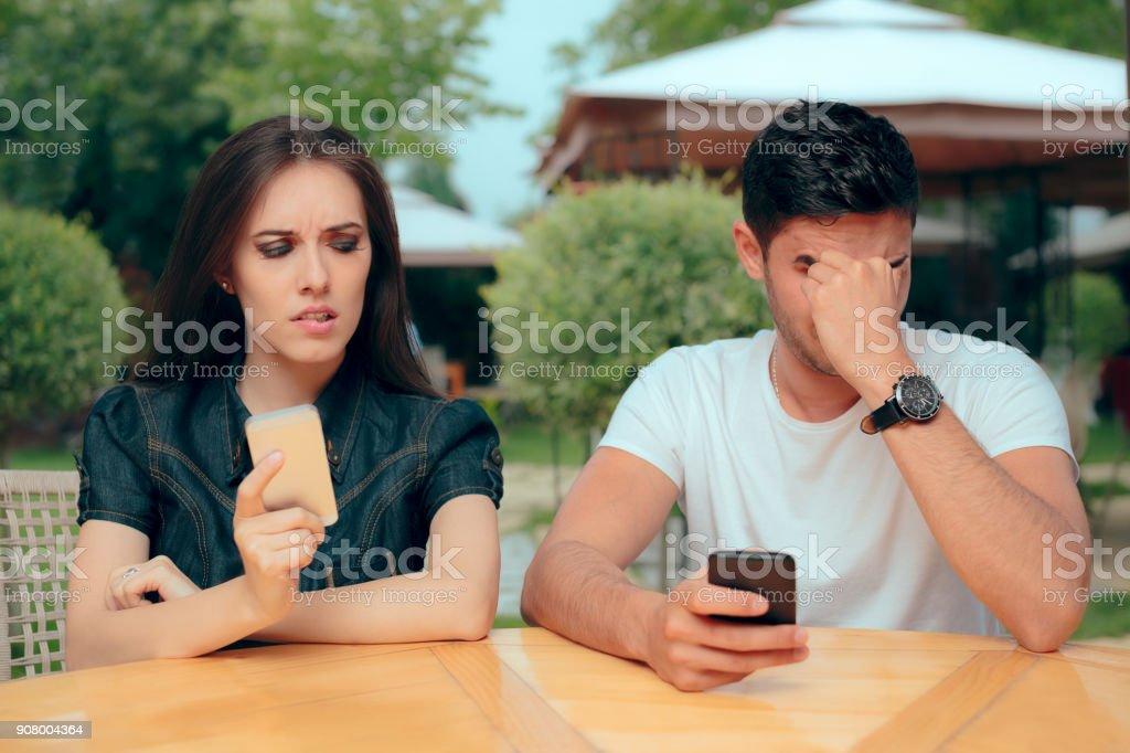 Curious Girlfriend Checking Boyfriend Phone Receiving Texts Messages stock photo