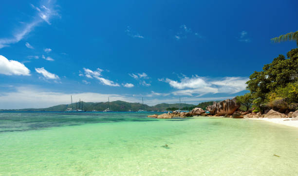Curious Island in the Seychelles - Sailing boats and catamarans stock photo