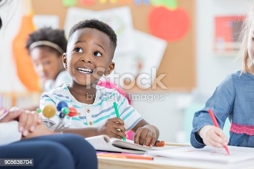 istock Curious little boy learns about solar system 905636704