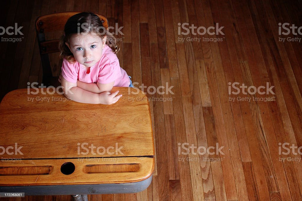 Curious Little Student Sitting in School Desk royalty-free stock photo