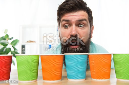 Curious man looks on colorful coffee cups. Color your day. Different types of coffee drinks in cafe menu. large assortment. assortment of coffee. energy drink assortment. bearded man want to drink.