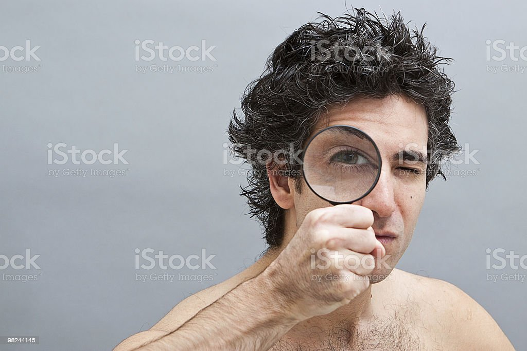 Curious man with magnifier royalty-free stock photo