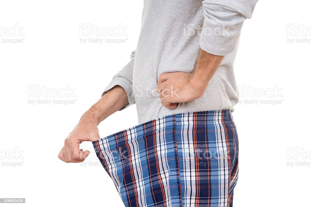 Curious Old Man Looking in His Boxer Short stock photo