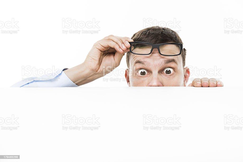 Curious Peeking Businessman Raising Glasses royalty-free stock photo