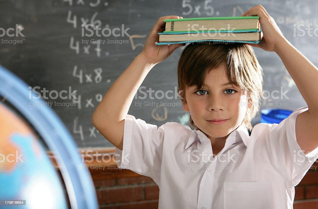 curious schoolboy hold textbooks royalty-free stock photo