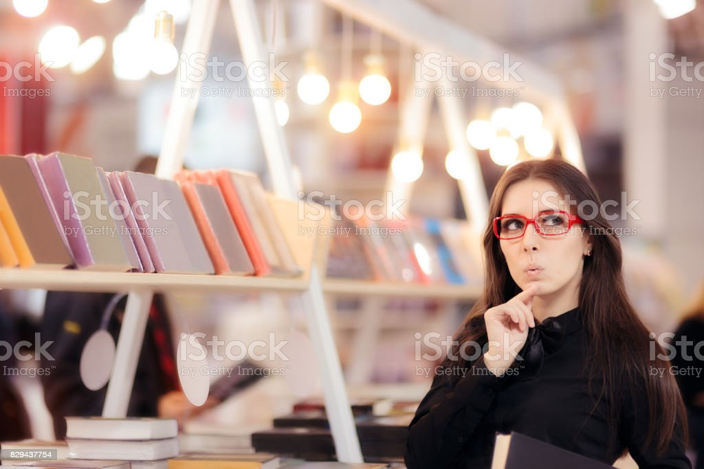 Curious Student Girl Thinking what Books to Buy stock photo