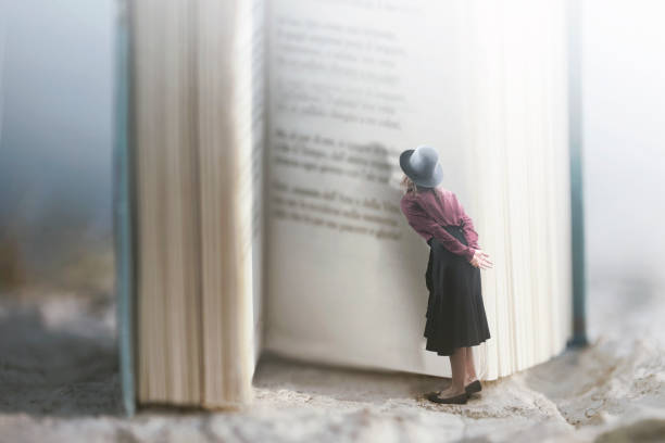Curious woman reads a giant book stock photo