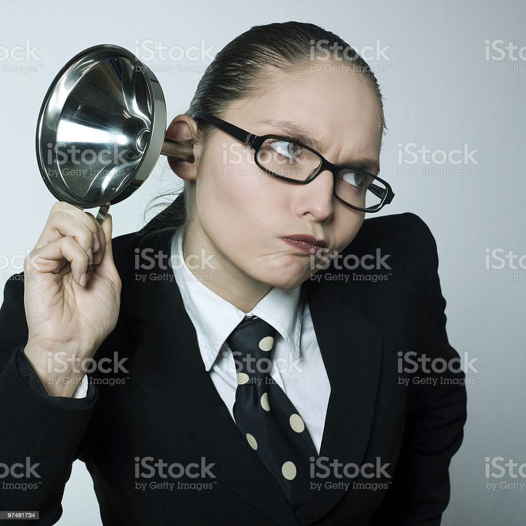 curious woman with hearing aid royalty-free stock photo