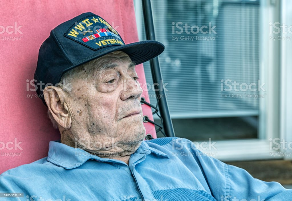 Curious WWII and Korean Conflict Military Veteran Looking Away stock photo