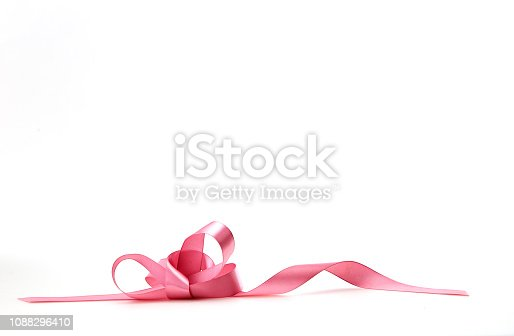 istock Curled pink ribbon on white background 1088296410