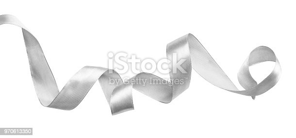 Curled silver silk ribbon isolated on white