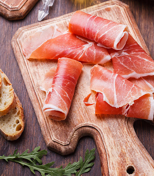 Curled Slices of  Prosciutto stock photo
