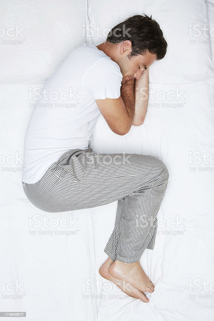 Curled up comfortably stock photo