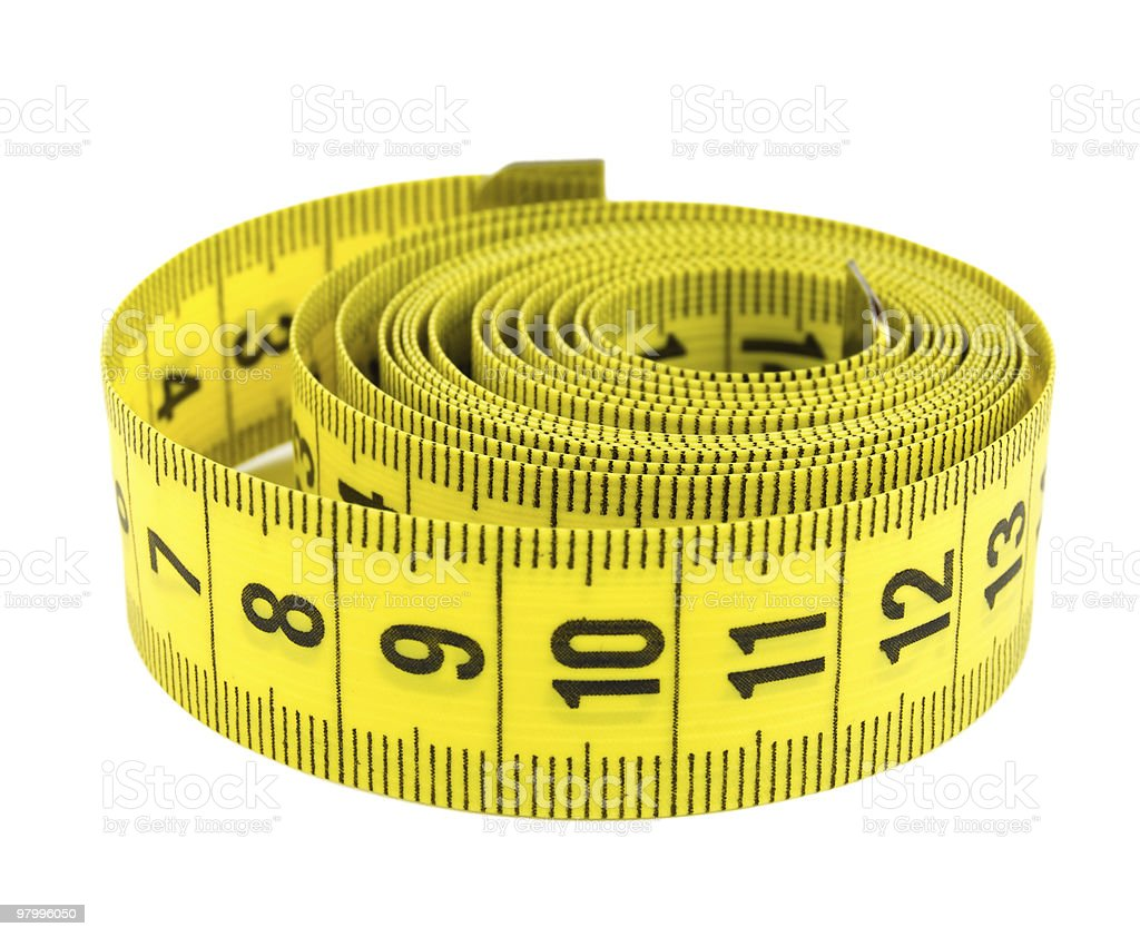 Curled yellow measuring tape royalty free stockfoto