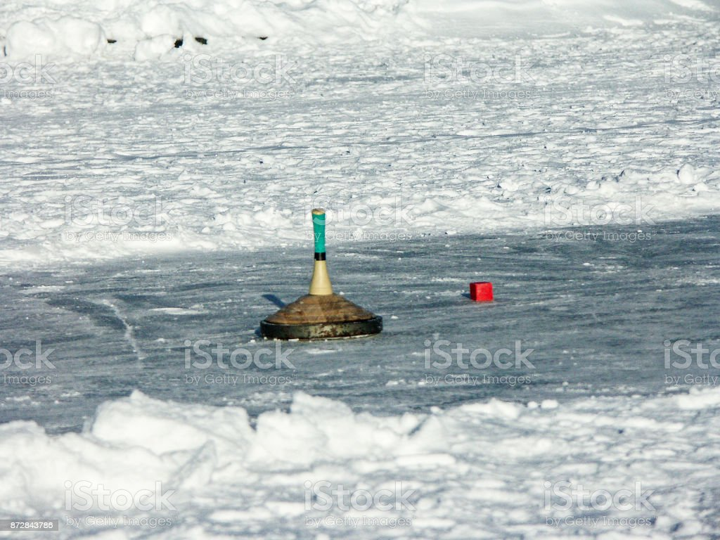 Curling on a frozen lake stock photo